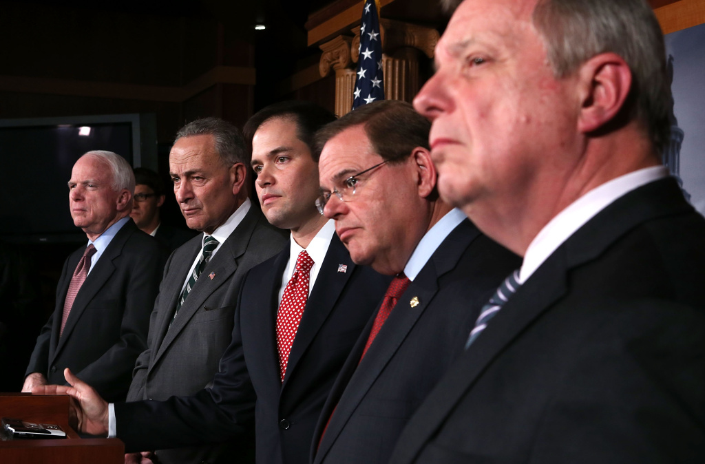 (L-R) U.S. Sen. John McCain (R-AZ), Sen. Charles Schumer (D-NY), Sen. Marco Rubio (R-FL), Sen. Robert Menendez (D-NJ), and Senate Majority Whip Sen. Richard Durbin (D-IL) listen during a news conference on a comprehensive immigration reform framework January 28, 2013 on Capitol Hill in Washington, DC. A group of bipartisan senate members have reached to a deal of outlines to reform the national immigration laws that will provide a pathway for the 11 million illegal immigrants in the country to citizenship.