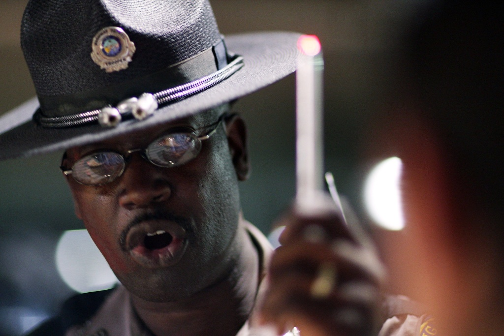 Florida Highway Patrol trooper Raymond Addison conducts a field sobriety test at a DUI traffic checkpoint June 4, 2007 in Miami, Florida. How many drinks would put your blood alcohol level at .05?