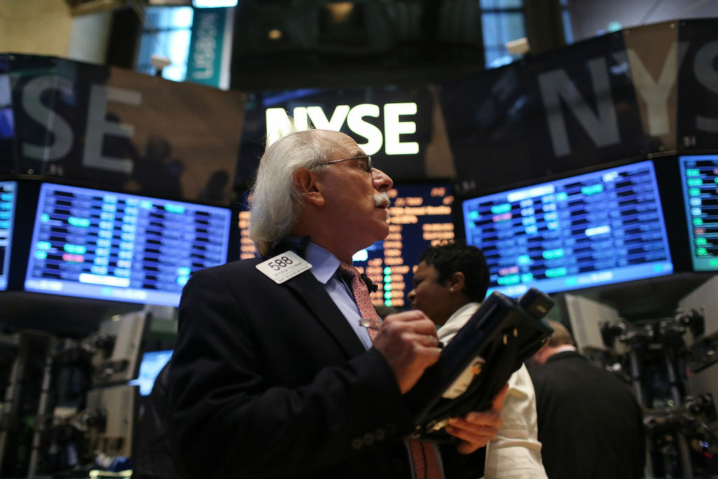 A trader works on the floor of the New York Stock Exchange on January 2, 2013 in New York City.