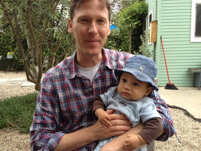 Rob Schmitz with a friend's baby.
