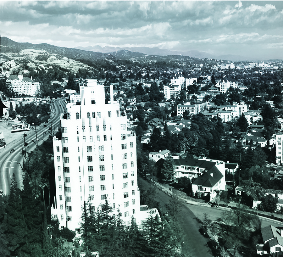 In 1949, Sunset Tower overlooks the Sunset Strip as Sunset Boulevard winds eastward past the Chateau Marmont toward Hollywood, with the Hollywood hills and San Gabriel range in the background.
