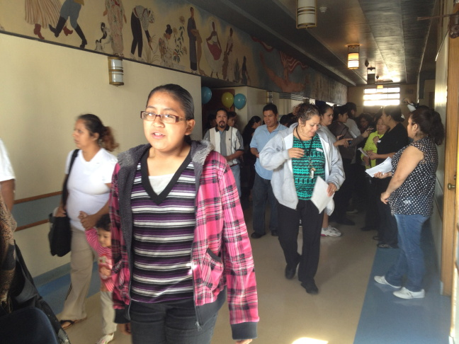Parents line up outside Hollenbeck Middle School in Boyle Heights for the first session of Parent College.
