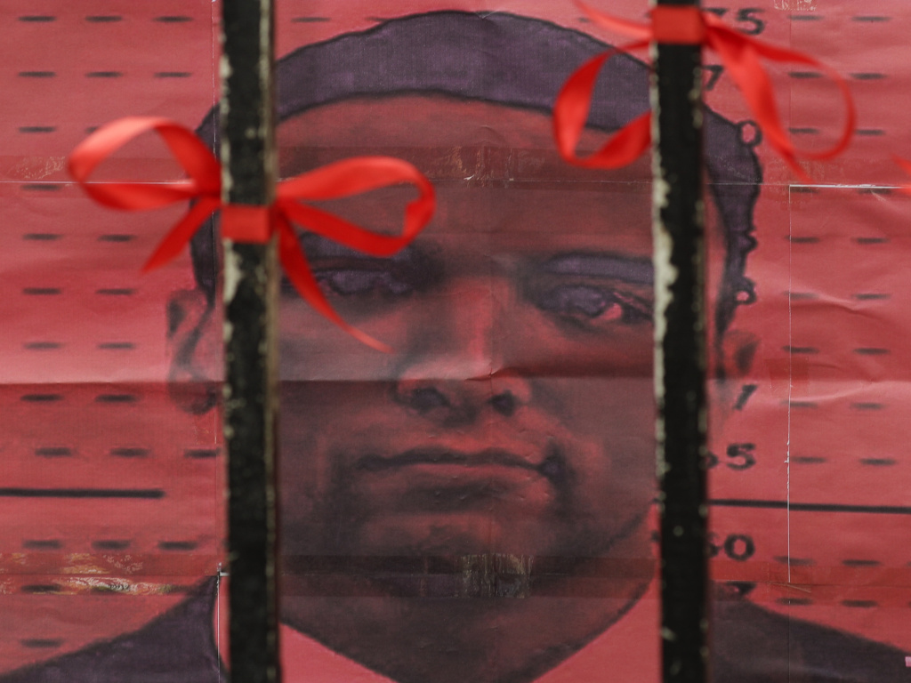U.S. Marine Lance Cpl. Joseph Scott Pemberton is seen from behind the gates of the Department of Justice in Manila, Philippines. Philippines President Rodrigo Duterte granted Pemberton a pardon following his conviction in the 2014 killing of a transgender Filipino woman.