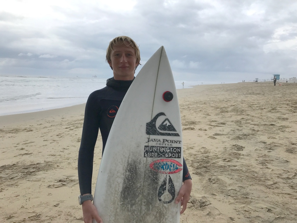 Fifteen-year-old Griffin Foy is among competing in an international contest remotely through a small, flat disc called a Trace that's attached to his surfboard.