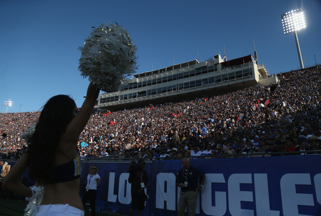 File: A cheerleader performs before the capacity crowd during the game between the Dallas Cowboys and the Los Angeles Rams at the L.A. Coliseum during preseason on Aug. 13, 2016. The Rams won 28-24.