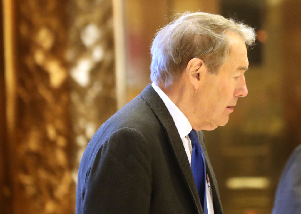 Journalist Charlie Rose arrives at Trump Tower in New York City in this November 21, 2016 file photo. CBS has fired the veteran newsman over accusations of sexual misconduct.