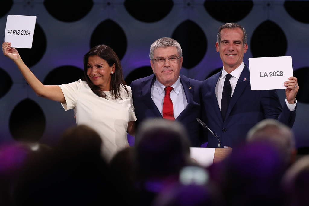 Paris Mayor Anne Hidalgo, IOC President Thomas Bach and Los Angeles Mayor Eric Garcetti react after the confirmation of the tripartite agreement which awards Paris and LA with the Olympic Games of  2024 and 2028 during the 131th IOC Session - 2024 & 2028 Olympics Hosts Announcement at Lima Convention Centre on September 13, 2017 in Lima, Peru.