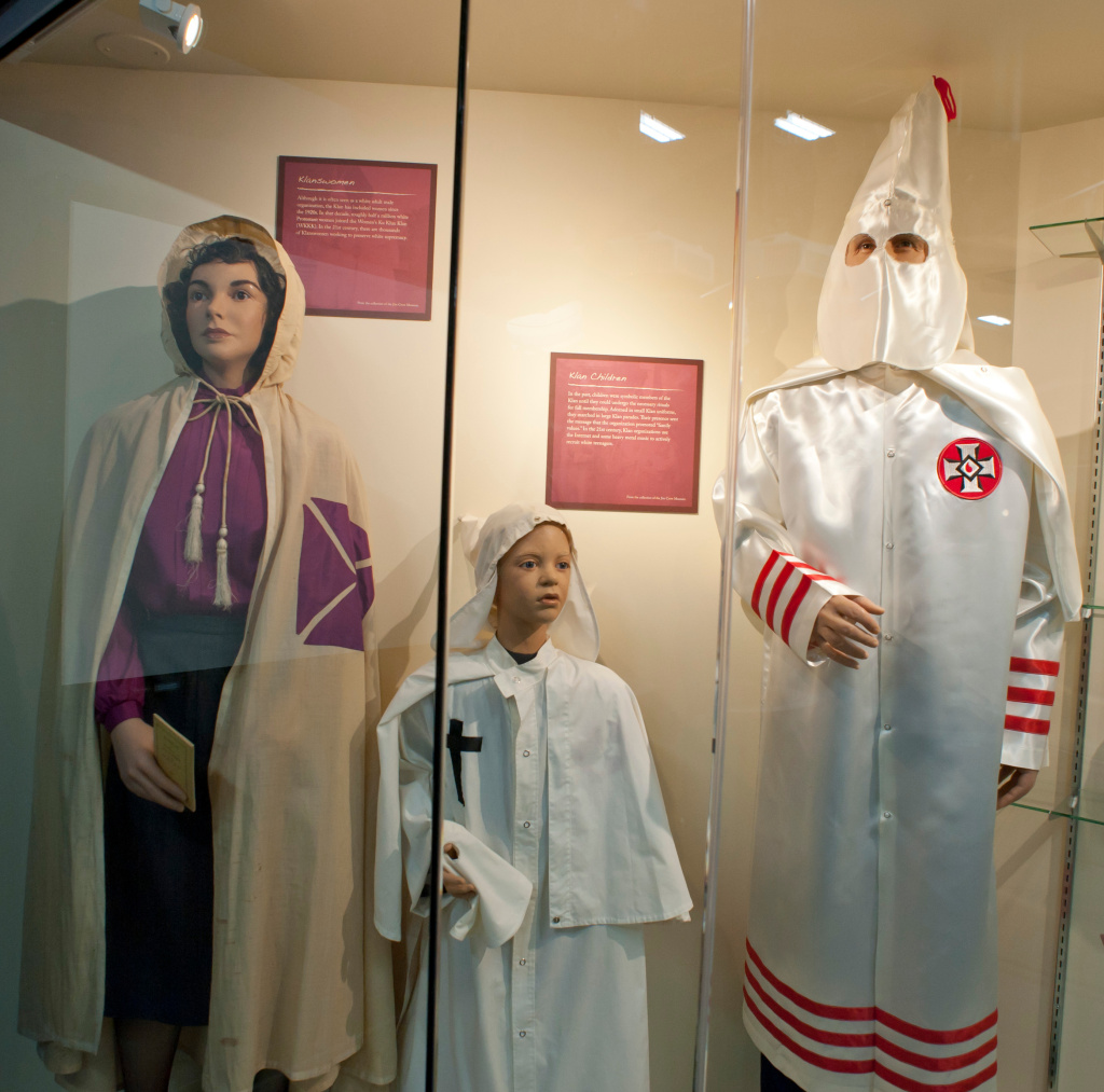 File: A display containing Ku Klux Klan attire is seen at the Jim Crow Museum of Racist Memorabilia at Ferris State University.