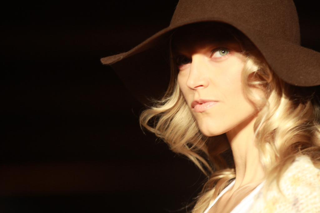 Model strikes a pose in a floppy, 70's inspired, felt hat at the First.LA Fall 2012 runway show.