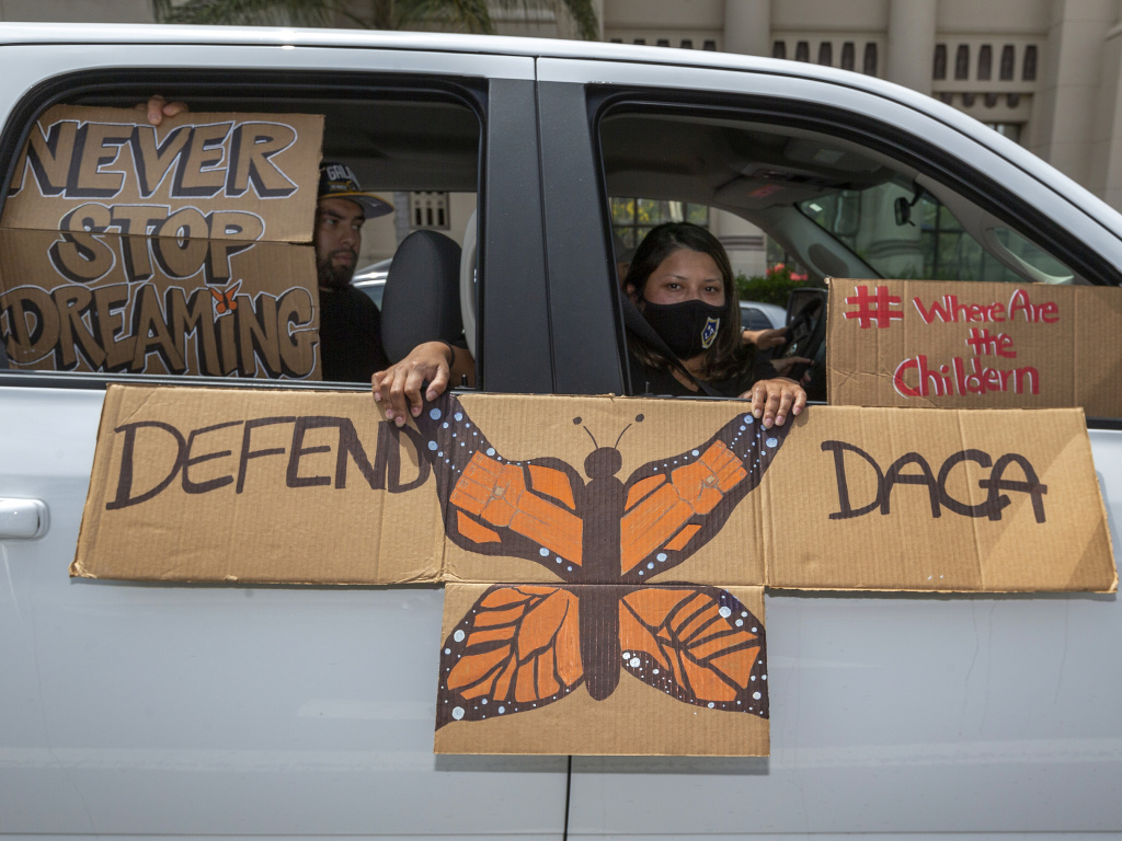 People demonstrate in June in Los Angeles in favor of the Deferred Action for Childhood Arrivals program. Immigrant rights advocates hailed a Friday court ruling allowing new applications as a