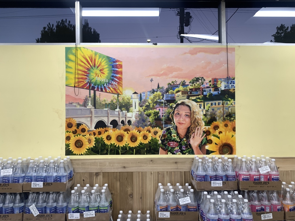 A memorial painting at the Trader Joe's store in Silver Lake pays tribute to Melyda Corado, an assistant manager killed when police traded gunfire with a suspected kidnapper on July 21, 2018.,