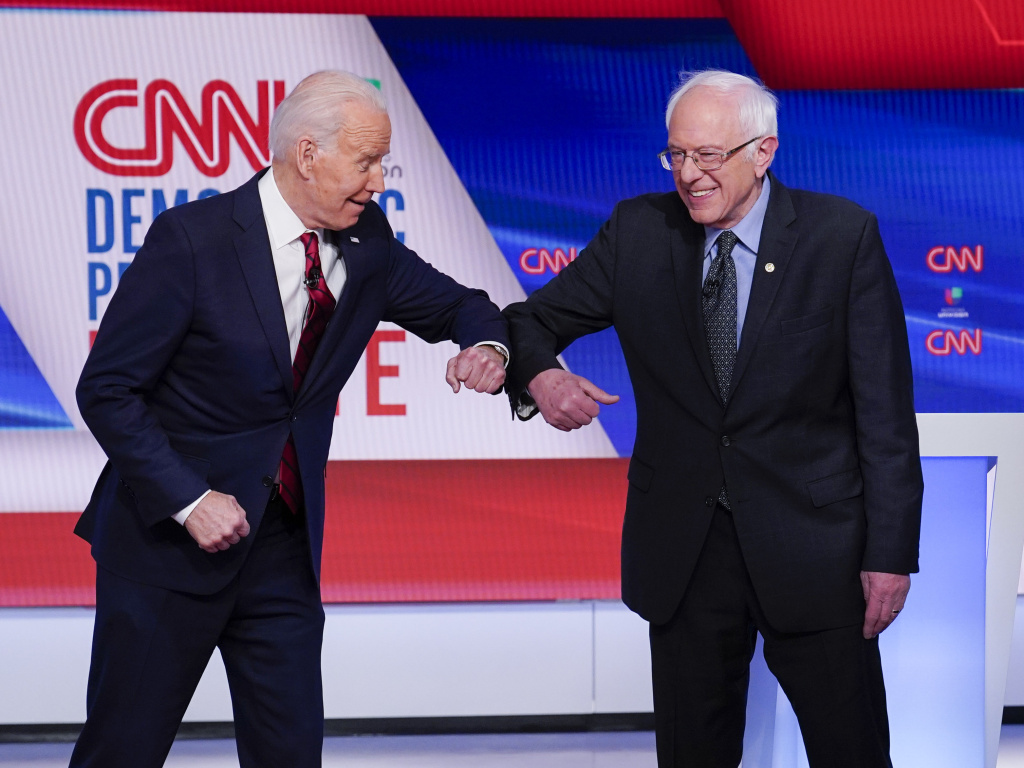 Former Vice President Joe Biden, left, and Sen. Bernie Sanders, I-Vt., greet one another before they participate in a Democratic presidential primary debate.