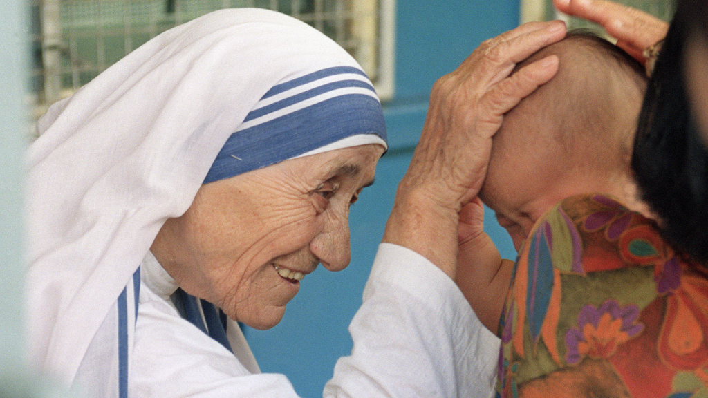File: Mother Teresa, seen here giving her blessing to a child in 1993, will be made a saint, after Pope Francis issued a decree recognizing a second miracle attributed to her.