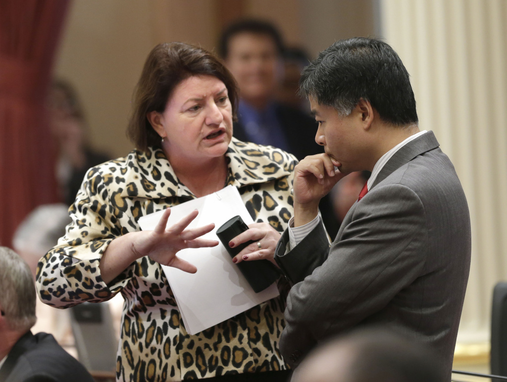 In this photo taken Sept. 3, 2013, Assemblywoman Toni Atkins, D-San Diego, talks with Sen. Ted Lieu, D-Torrance, at the Capitol in Sacramento, Calif.  Gov. Jerry Brown signed Atkins bill, AB154, that will allow Nurse practitioners, certified nurse midwives and physician assistants in California to perform a type of early abortion, Wednesday, Oct, 9, 2013. But opponents have been approved to begin a signature-gathering referendum campaign to put the issue before voters.