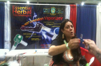Christa Picconotti of Essential Herbal Technologies sells high-end smoking pipes and vaporizers at HempCon 2010 at the Los Angeles Convention Center, Sept. 10, 2010.