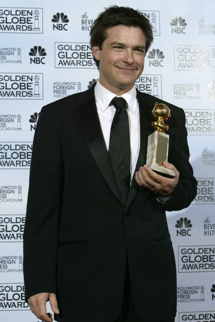 "U.S. actor Jason Bateman poses with his ""Best Actor in a Televison Series - Musical or Comedy"" for his performance in ""Arrested Development,"" at the 62nd annual Golden Globe Awards show Jan. 16 2005, in Beverly Hills, Calif. Netflix will exclusively stream a new season of the cult hit — and that could bring the service a lot of new subscribers, one analyst says."