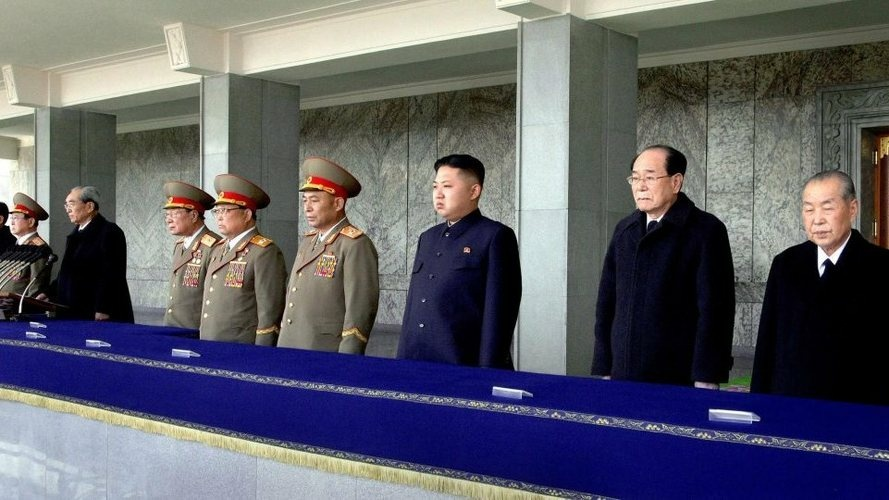 North Korean leader Kim Jong Un (third from right) and other senior leaders attend a memorial service in Pyongyang, March 25, marking the 100th day since the death of Kim's father, Kim Jong Il.