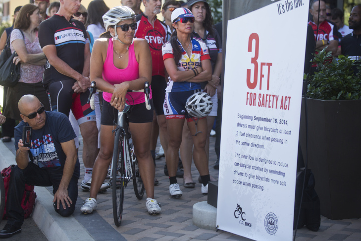 Cyclists attend a press conference for the Three Feet for Safety Act on Wednesday morning, Sept. 10 at Serious Cycling in Northridge. Starting September 16, drivers must give cyclists at least three feet of clearance.