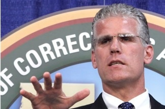 Corrections Secretary Matthew Cate answers a question concerning his departments proposal to reduce the California's inmate popluation, during a news conference in Sacramento, Calif., Friday, Sept. 18, 2009.