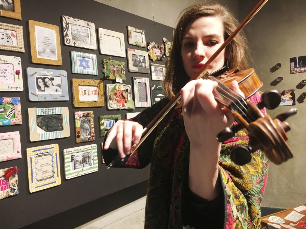 Maria Sławek plays violin at the Los Angeles Museum of the Holocaust.