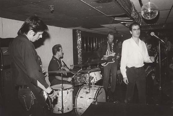 The Flesh Eaters, playing live. From left to right: John Doe, Bill Bateman, Dave Alvin, Chris Desjardins, and Steve Berlin.