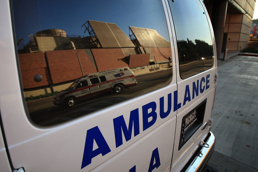 An ambulance transporting a patient is reflected in the window of another ambulance at Ronald Reagan UCLA (University of California Los Angeles) Medical Center on October 9, 2008 in Los Angeles, California.