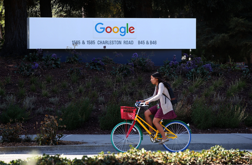 The new Google logo is displayed on a sign outside of the Google headquarters.