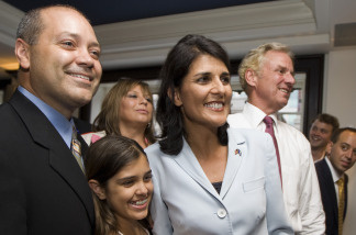 Republican candidate for South Carolina Governor Nikki Haley (R) smiles along with her husband Michael Haley (L) and daughter Rena (C) as they watch the runoff election results at the Columbia Sheraton on June 22, 2010 in Columbia, South Carolina. Haley defeated Rep. Gresham Barrett in a runoff election.