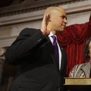 Vice President Joe Biden swears in Sen. Cory Booker (D-NJ) as his mother, Carolyn, holds a Bible on Thursday.