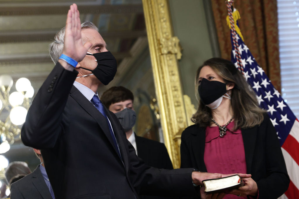 Former White House Chief of Staff Denis McDonough (L) is sworn in as the Secretary of the Department of Veterans Affairs as his wife Kari McDonough (R) looks on February 9, 2021 at Eisenhower Executive Office Building in Washington, DC.