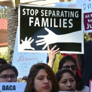 Children hold banners and placards while listening to speakers at a rally outside the 9th Circuit federal court in Pasadena, California on July 16, 2015, where Immigrant rights organizations, labor, and Deferred Action for Childhood Arrivals (DACA) recipients from Arizona and Los Angeles gathered.