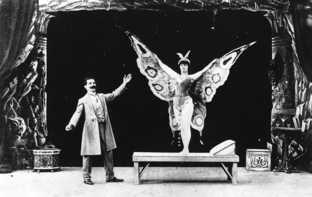 French actor, magician, designer and theatre manager Georges Melies in a film in which he turns a sleeping woman into a butterfly.