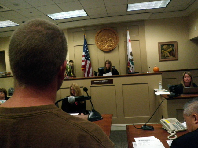 A military veteran stands before Judge Wendy Lindley at Orange County's Veterans Court. Combat veterans who have committed a violent crime can submit their case to the court and take on a minimum 18-month rehab program to avoid jail time.