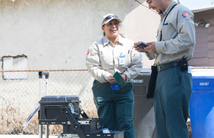 Maria Rodriguez, a mosquito control technicians from the Los Angeles County Vector Control District inspects a backyard  Commerce to looks for invasive mosquito species such as the Aedes Aegypti, (yellow fever mosquito), on Wednesday, July 29, 2015. The mosquitos only require a small amount of water to breed in, and bite during the day.