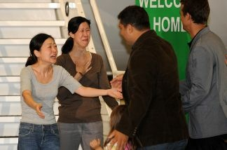 Lisa Ling (right) is relieved to see her sister Laura arrive safely home after five months in North Korean custody.