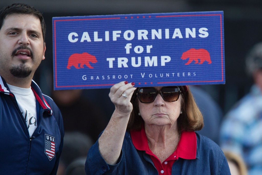 File: A supporter of Republican presidential candidate Donald Trump holds a sign during his campaign rally at the Orange County Fair and Event Center, April 28, 2016, in Costa Mesa, California.