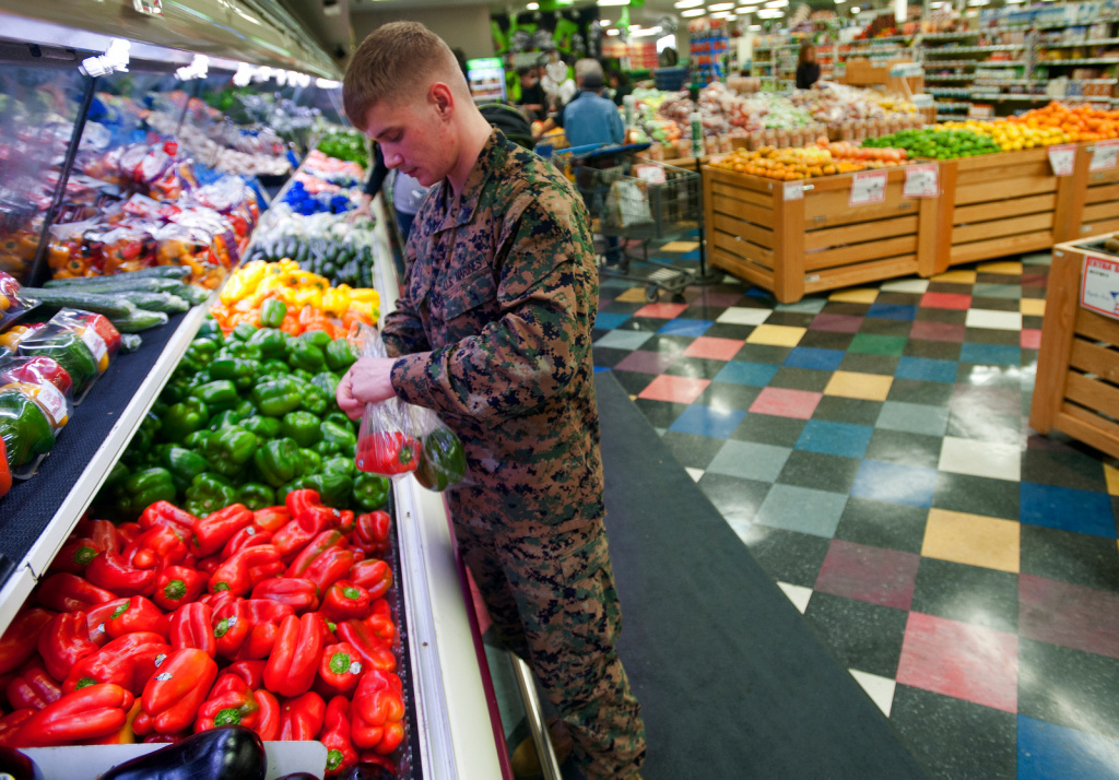 The Camp Pendleton commissary remains open on Tuesday, in order to sell off perishable goods. But base officials expect it to close by Wednesday. Cpl. Todd Zell bags bell peppers at the Commissary on Jan. 24, 2013. This is Zell's first time in the store, as he was just stationed at Camp Pendleton.