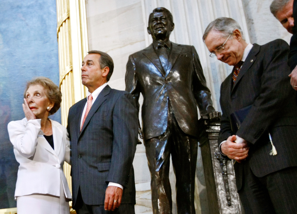 Nancy Reagan wipes away a tear after the unveiling of a statue of former President Ronald Reagan in the Rotunda of the U.S. Capitol on June 3, 2009 in Washington, D.C. Also pictured, from left to right,  are House Minority Leader Rep. John Boehner, R-Ohio, and Senate Majority Leader Harry Reid, D-Nevada.