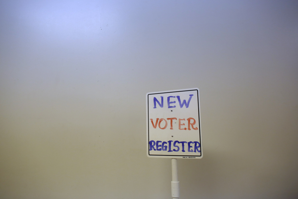 FILE: A voter registration sign is seen at a polling station on November 6, 2012 in Richmond, Wisconsin.