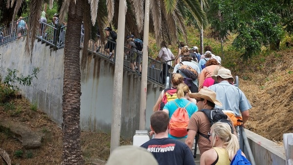 Hikers climb one of the many public stairways on the Big Parade route.