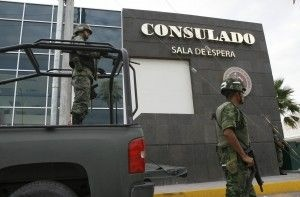 Mexican soldiers guard one of the entrances in July 2010 to the U.S. consulate in Ciudad Juarez, Mexico, where undocumented Mexican nationals who marry U.S. citizens are typically sent to apply for green cards. Under current rules, many get stuck there long-term.