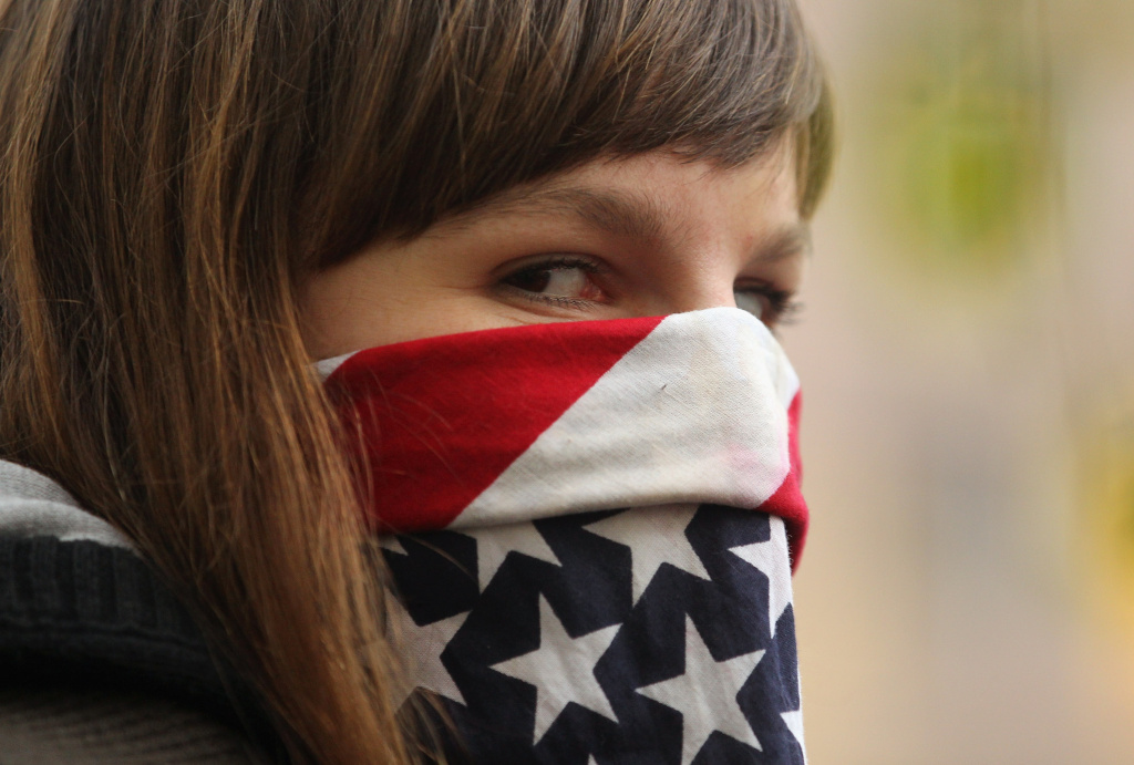 A protester affiliated with Occupy Wall Street demonstrates near Mayor Michael Bloomberg's Upper East Side home on November 20, 2011 in New York City.