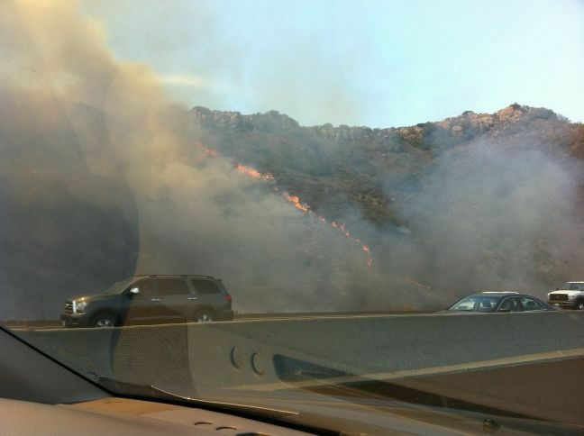 Brush fire is seen near the 101 Ventura Freeway near Camarillo.