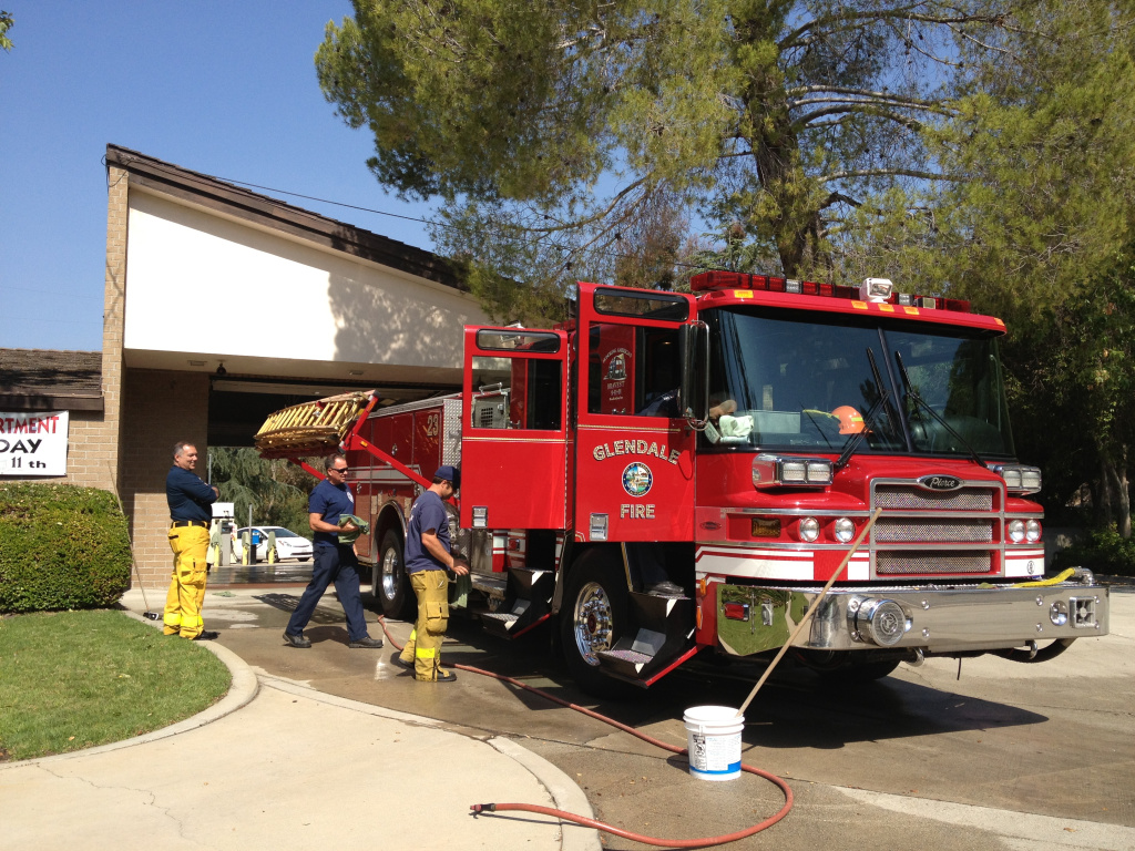 File: Firefighters from Glendale's 23rd company clean the truck the morning after putting out a rapid brush fire that threatened many homes.