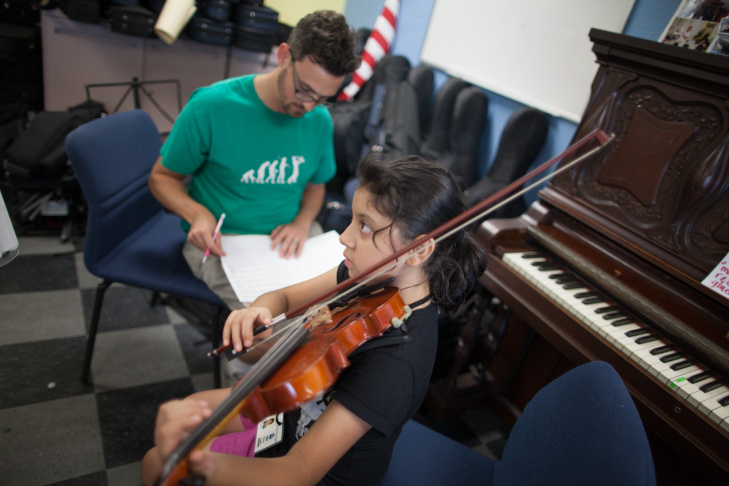 Mayte Castro, a violinist in the Boyle Heights Community Youth Orchestra, plays during rehearsal at the Boys and Girls Club.