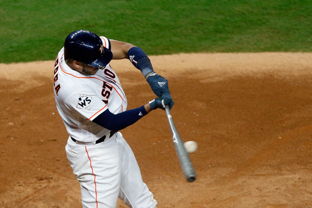 HOUSTON, TX - OCTOBER 27: Carlos Correa #1 of the Houston Astros hits a single during the eighth inning against the Los Angeles Dodgers in game three of the 2017 World Series at Minute Maid Park on October 27, 2017 in Houston, Texas.  (Photo by Bob Levey/Getty Images)
