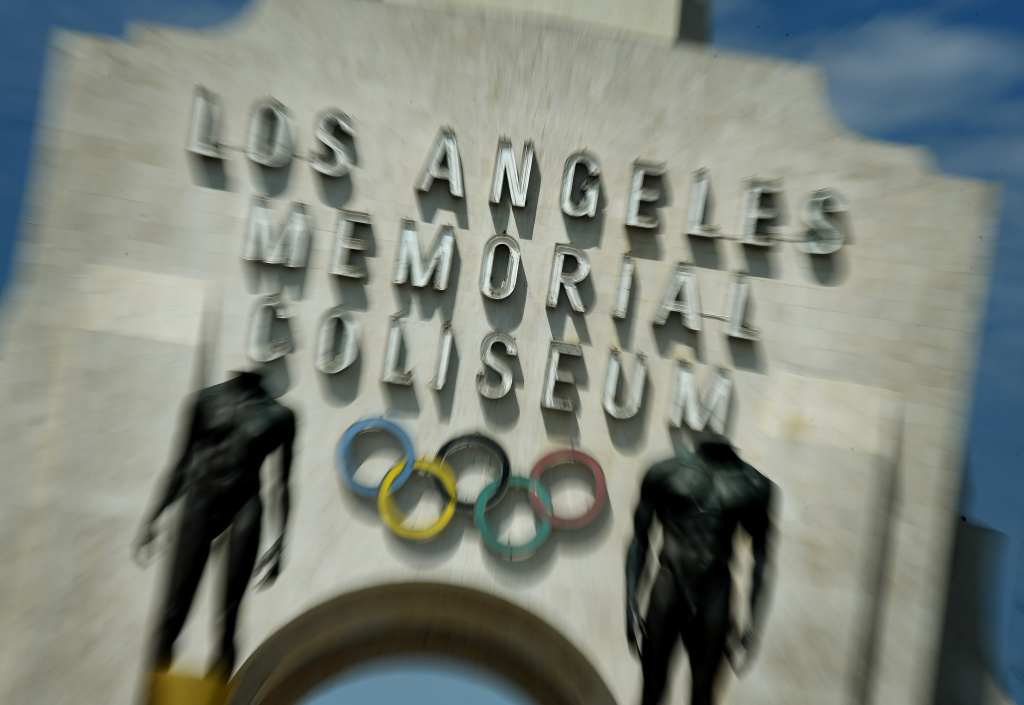 The Los Angeles Memorial Coliseum, venue for two previous Olympic Games, is seen in this on August 26, 2015 in Los Angeles, California. The Coliseum would be renovated and used as the main stadium if the city bids for the 2024 Summer Olympics. The Los Angeles city council is reviewing a $4.1 billion bid proposal for the 2024 Summer Olympics that backers say could produce a surplus of $161 million if the city is awarded a third Summer Games. A 218-page bid book made public on August 25 shows plans for a Los Angeles Games rely on private-sector partners to pay more than $1.7 billion in venue costs and includes revenue projections such as $4.8 billion from ticket sales, broadcast rights and corporate sponsorships.       AFP PHOTO / MARK RALSTON        (Photo credit should read MARK RALSTON/AFP/Getty Images)