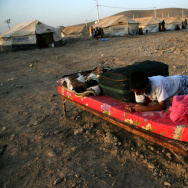 Syrian-Kurdish children sit on a bed at the Quru Gusik refugee camp in the Kurdish region of northern Iraq, on Aug. 22. Faced with brutal violence and soaring prices, thousands of Syrian Kurds have poured into Iraq's autonomous Kurdish region. UNICEF has