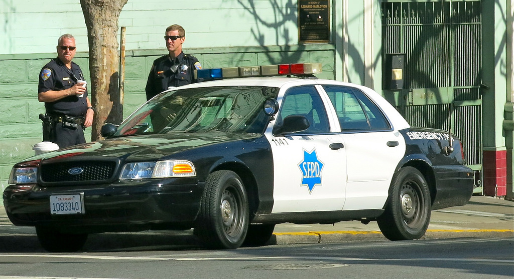 File photo shows two officers in the Castro area of San Francisco. 3 judges will review 3,000 past arrests as part of a probe involving 14 San Francisco city police officers linked to racist and homophobic text messages.
