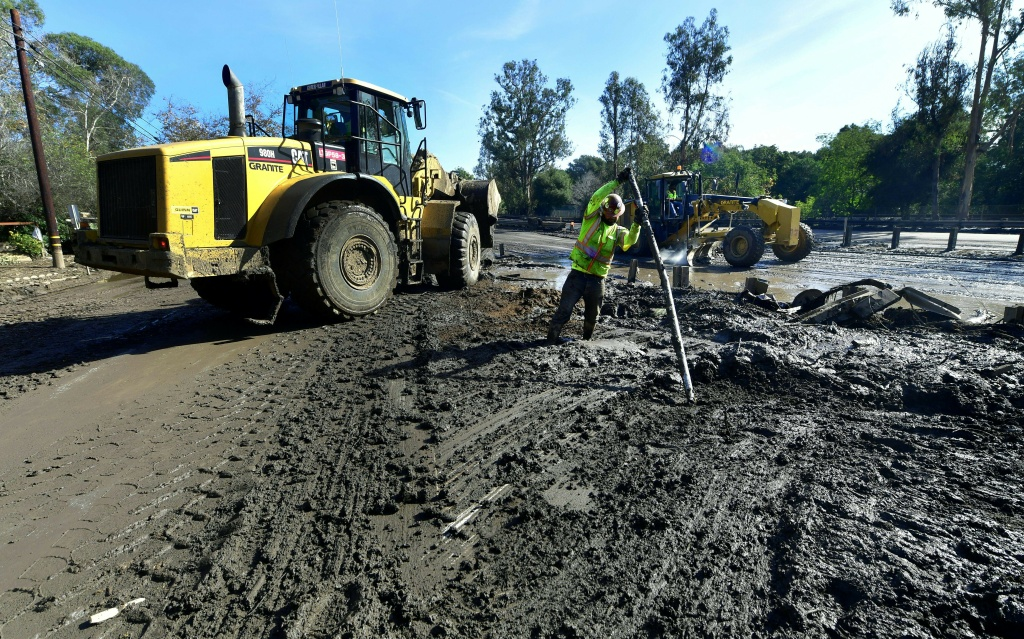 Clean-up operations continue on a section of the US 101 freeway, which was closed because of mudslides in Montecito, California on January 12, 2018.